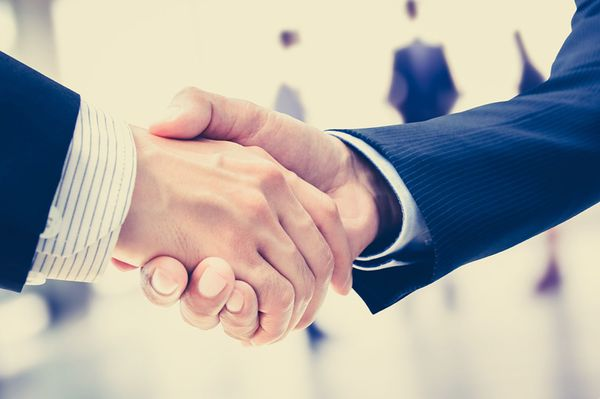 Handshake for hotel sales acquisition concept result