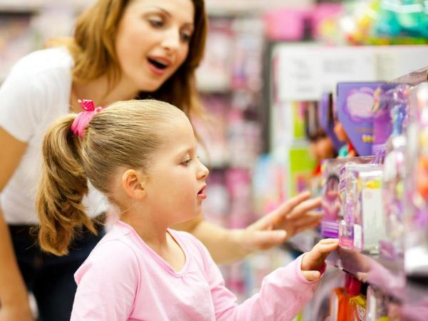 woman in store with child looking at toys on shelf result